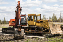 Tractor, standing in a row.  Parking of agricultural machinery. Stock Photo