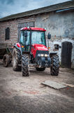 Tractor standing in the yard in rural areas.  royalty free stock photos