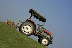 Tractor on a steep slope Royalty Free Stock Photo