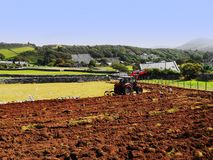 Tractor. Stock Photo Keywords  agricuture, field, plough field, plough soil, ploughed, ploughed field, ploughed fields, ploughed soil, ploughing, ploughing Stock Photography