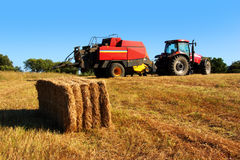 Tractor and Straw Stock Images