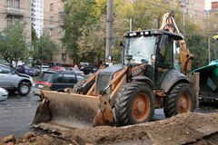 Tractor on the street. Service mashine (tractor) on the moscower street Stock Photography