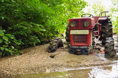 Tractor stuck in the mud Royalty Free Stock Images
