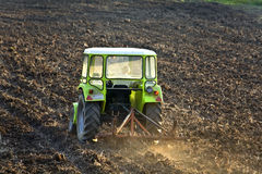 Tractor subsoiling field Royalty Free Stock Images