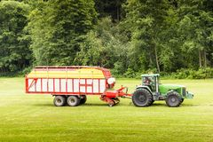 Tractor in the summer field. Czech Republic Stock Photo