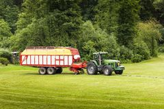 Tractor in the summer field. Green tractor in the summer field. Czech Republic Royalty Free Stock Images