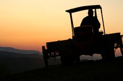 Tractor at sunset Royalty Free Stock Images