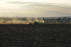 Tractor at sunset. Tractor in a plowed field at sunset Royalty Free Stock Photography