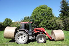 Tractor Taking Hay Bales To Livestock Royalty Free Stock Image