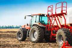 Tractor with tanks in the field. Agricultural machinery and farming. Royalty Free Stock Photography