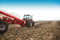 Tractor with tanks in the field. Agricultural machinery and farming. Stock Photography