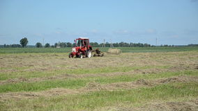 Tractor ted hay field stock footage