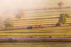 Tractor with a tedder Royalty Free Stock Photo