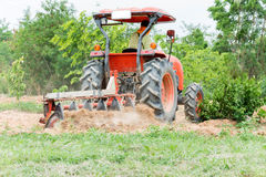 Tractor tilling in field Royalty Free Stock Images