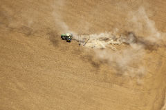 Tractor tilling soil Stock Images