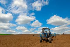 Tractor in tilth. Agriculture tractor in the spring fields Stock Image