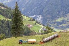 Tractor and a timber log Royalty Free Stock Image