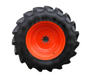 Tractor tire. With red hubcap, isolated on white background Stock Photography