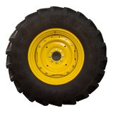 Tractor Tire. John Deere tractor tire with yellow hubcap, isolated on white background Royalty Free Stock Photography