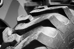 Tractor Tire Treads. Close up of a heavy treads on truck tire Stock Photo