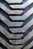 Tractor tire with mud. Visible Royalty Free Stock Photography