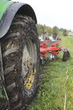 Tractor Tire and Plough Stock Photos