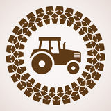 Vector tractor tire print with symbol of tractor Royalty Free Stock Images
