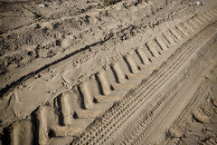 Tractor tire tracks on beach sand Stock Photos