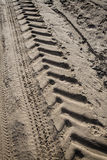 Tractor tire tracks on beach sand Royalty Free Stock Image