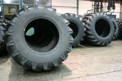 Tractor tires. Brand new tractor tires placed on factory floor ready to be transported to tiers shop Royalty Free Stock Photos