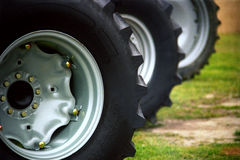 Tractor Tires. Three farm tractor tires, lined up diagonally in the image from left to right Stock Images