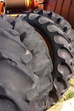 Tractor Tires. Four old tractor tires stacked against an implement Royalty Free Stock Image