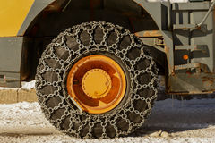Tractor tires with chains in the snow Stock Photo