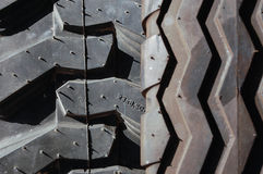 Tractor tires close-up background. Two different new tires used for agriculture machinery, vehicles Royalty Free Stock Photos
