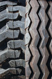 Tractor tires close-up background. Two different new tires used for agriculture machinery, vehicles Stock Image