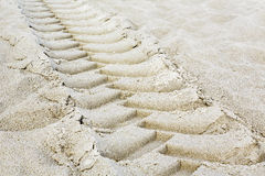 Tractor tires footprint. On a sandy beach Royalty Free Stock Images