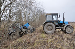 Tractor towing stuck tractor Royalty Free Stock Photo
