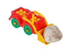 Tractor toy and stone Royalty Free Stock Photography