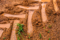 Tractor trail closeup on the soil Royalty Free Stock Photo