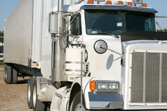 Tractor trailer. Front view of a white tractor with trailer Stock Photos