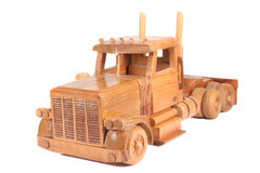 Tractor Trailer. Wooden toy tractor trailer isolated on white Stock Images