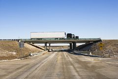 Tractor trailer on bridge. Royalty Free Stock Images