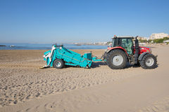 Tractor with trailer cleaning beach in Benicassim Stock Photos
