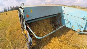 Tractor Trailer Collecting Hay Left By Combine stock footage