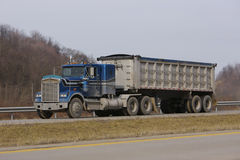 Tractor Trailer Dump Truck. Semi Truck Dump Trailer on Highway Stock Image