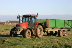 Tractor and Trailer on Farm Royalty Free Stock Images