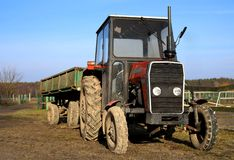 Tractor with a trailer on the farm stock images