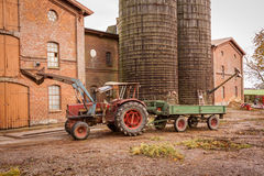 Tractor and trailer in a farmyard Stock Photos