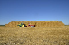Tractor and trailer in front of stock for straw Royalty Free Stock Photos