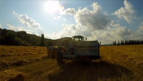 Tractor With Trailer Making Hay Bales stock video